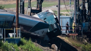 Emergency crews respond to the scene of a train derailment near Chambers Bay on July 2, 2017, in Tacoma, Wash. (Joshua Bessex/The News Tribune via AP)