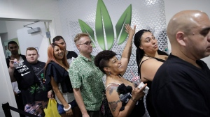 People wait in line at the Essence cannabis dispensary, in Las Vegas, Nevada, on Saturday, July 1, 2017. (AP Photo/John Locher)