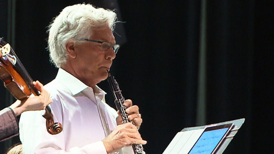 Federal Minister of Natural Resources Jim Carr plays oboe with the Winnipeg Symphony Orchestra in honour of the WSO's 70th birthday celebrations.