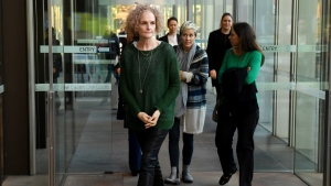 Members of the class action against Johnson & Johnson, Gai Thompson, left, Joanne Maninon, center, and Carina Anderson, right, arrive to address the media outside the Federal Court in Sydney on Tuesday, July 4, 2017. (Paul Miller / AAP Image)