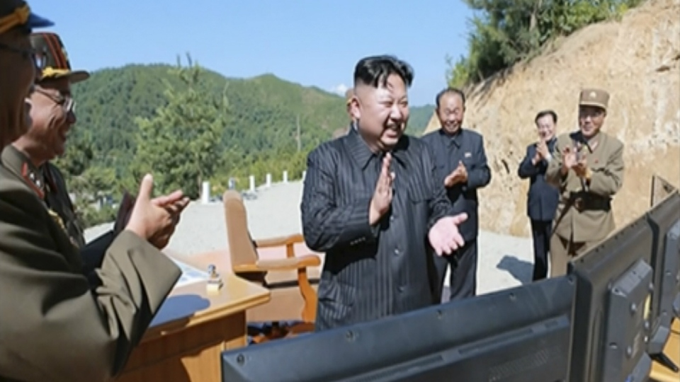 North Korea leader Kim Jong Un, centre, is seen applauding after the launch of a Hwasong-14 intercontinental ballistic missile, ICBM, in North Korea's northwest on July 4, 2017. (KRT)