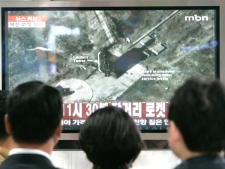 South Koreans watch a TV news program on North Korea's rocket launch at a train station in Seoul, Sunday, April 5, 2009. (AP / Ahn Young-joon)