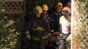 A woman was found Tuesday afternoon in the area of Scott Road and 96A Avenue, trapped at the bottom of an embankment.