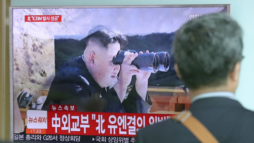 A man walks by a TV screen showing a local news program reporting about North Korea's missile firing with an image of North Korean leader Kim Jong Un, at Seoul Train Station in Seoul, South Korea on Tuesday, July 4, 2017. (AP / Lee Jin-man)