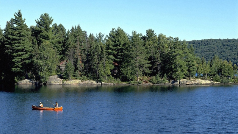 People canoe in Algonquin Provincial Park in Ont., Canada, in this file photo. (CP Photo / HO, Ontario Tourism 2005)