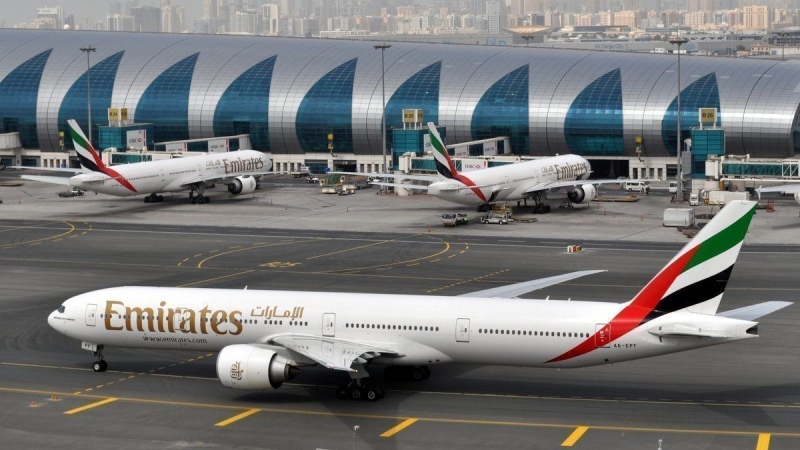In this March 22, 2017 file photo, an Emirates plane taxis to a gate at Dubai International Airport in Dubai, United Arab Emirates. (Adam Schreck/AP)