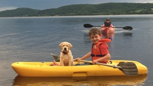 What a grand way to beat the summer heat! Gabe Sherwood and the newest family member Mazie on the Belleisle Bay, near Hatfield's Point NB.