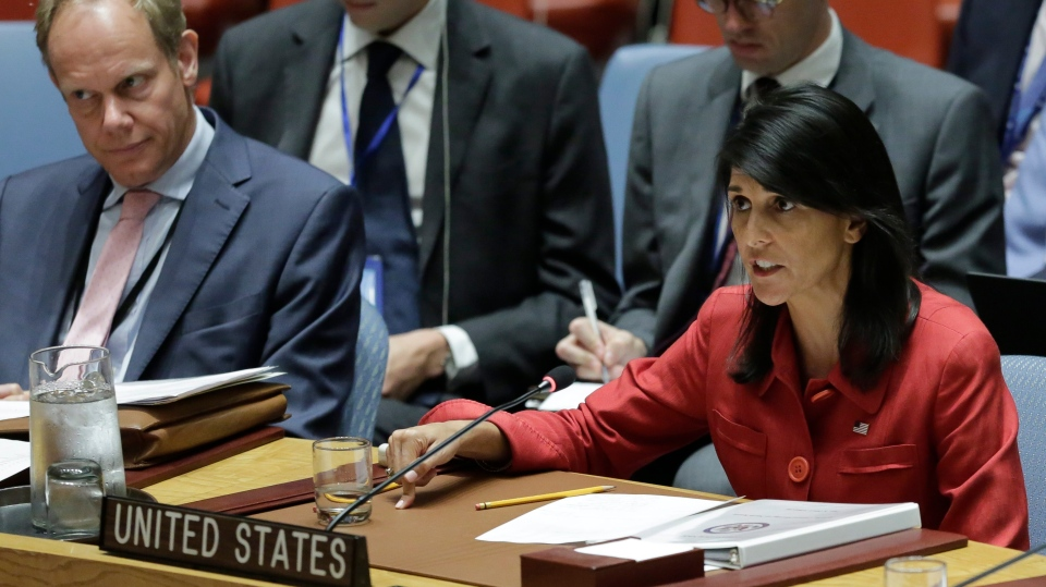 United Kingdom U.N. Ambassador Matthew Rycroft, left, listens as United States U.N. Ambassador Nikki Haley, right, respond to Russia's statements, during United Nations Security Council meeting on North Korea's latest launch of an intercontinental ballistic missile, Wednesday July 5, 2017 at U.N. headquarters. (AP / Bebeto Matthews)