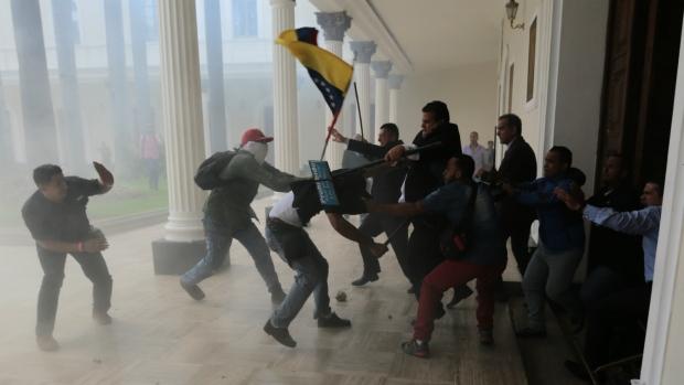 Venezuelan lawmakers beaten in latest violent flare-up