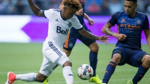 Vancouver Whitecaps' Yordy Reyna, left, tries to move the ball past New York City FC's Alexander Callens during the second half of an MLS soccer game in Vancouver, B.C., on Wednesday, July 5, 2017. (Darryl Dyck / THE CANADIAN PRESS)