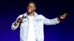 In this April 13, 2016 file photo, Kevin Hart, addresses the audience during the Universal Pictures presentation at CinemaCon 2016 in Las Vegas. Philadelphia is welcoming back its favorite funnyman, Hart, for a birthday celebration and the unveiling of a giant mural of the comedian near his childhood home. The festivities Thursday morning, July 6, 2017, will include an official resolution dubbing July 6 'Kevin Hart Day' in the city. (Photo by Chris Pizzello/Invision/AP, File)