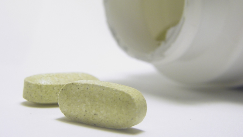 Supplements are seen in this undated file photo. A new study suggests Canadians are exposed to a large number of online ads for natural health products claiming to treat or cure cancer despite a total lack of scientific proof.