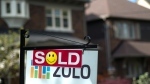 A sold sign is shown in front of west-end Toronto homes Sunday, May 14, 2017. (THE CANADIAN PRESS/Graeme Roy)