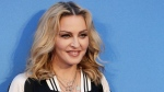 "n this Sept. 15, 2016 file photo, Madonna poses for photographers upon arrival at the World premiere of the film ""The Beatles, Eight Days a Week"" in London.  (AP Photo/Kirsty Wigglesworth, File)"