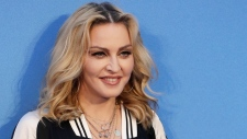 """n this Sept. 15, 2016 file photo, Madonna poses for photographers upon arrival at the World premiere of the film """"The Beatles, Eight Days a Week"""" in London.  (AP Photo/Kirsty Wigglesworth, File)"""