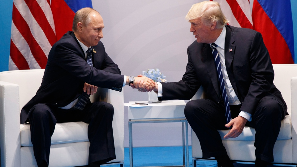 President Donald Trump shakes hands with Russian President Vladimir Putin at the G20 Summit at the G20 Summit, Friday, July 7, 2017, in Hamburg. (AP Photo/Evan Vucci)