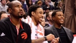 Toronto Raptors' Serge Ibaka, left to right, DeMar DeRozan and Kyle Lowry watch from the bench as their team takes on the Indiana Pacers during second half NBA basketball action, in Toronto on Sunday, March 19, 2017. THE CANADIAN PRESS/Frank Gunn