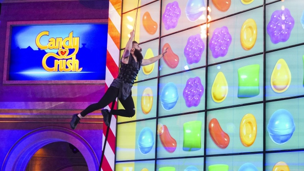 "This image released by CBS shows Paul Abrahamian, a former contestant on ""Big Brother 18"" and ""Survivor,"" competing in the new game show, ""Candy Crush,"" premiering, Sunday, July 9 at 9 p.m. ET. (Sonja Flemming/CBS via AP)"
