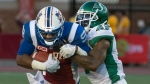 Saskatchewan Roughriders Jovon Johnson comes down on Montreal Alouettes Ernest Jackson during 2nd quarter CFL action in Montreal on Thursday June 22, 2017. (CFL PHOTO - Peter McCabe)