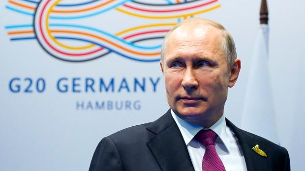 Russian President Vladimir Putin stands while waiting for Turkish President Recep Tayyip Erdogan prior to their talks at the G-20 summit in Hamburg, northern Germany, Saturday, July 8, 2017. (AP Photo/Alexander Zemlianichenko, Pool)