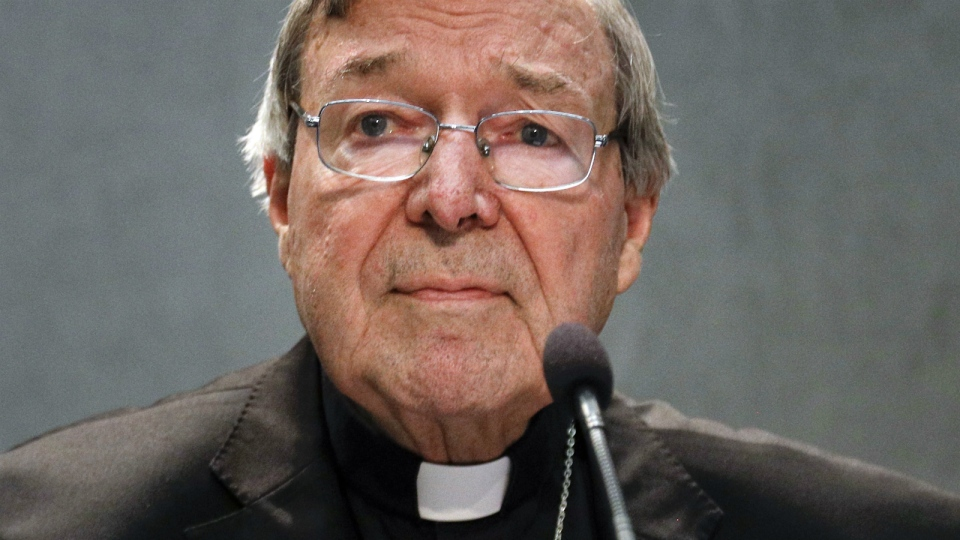 Cardinal returns to Australia to face charges