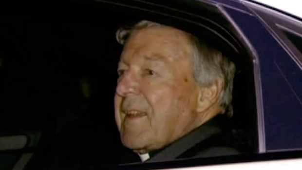 In this image made from video, Cardinal George Pell, Pope Francis' top financial adviser, sits in the back of a car as he leaves Sydney Airport, on July 10, 2017. (CHANNEL 9 via AP)
