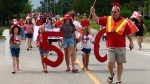 Residents and cottagers in Ipperwash, Ont. hold an impromptu parade for Canada 150th celebrations (Photo submitted by Kim D'Amore)
