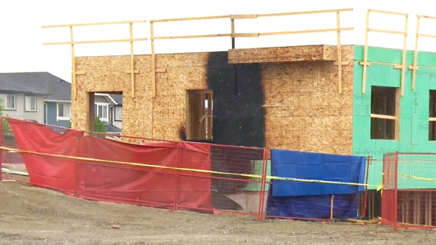 In this file photo, police investigate a Calgary construction site on July 10, 2017 in connection with four deaths.
