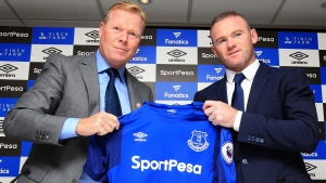 England soccer star Wayne Rooney, right, holds an Everton shirt with his new manager Ronald Koeman during the press conference at Goodison Park, Liverpool, England Monday July 10, 2017. (Nigel French/PA via AP)