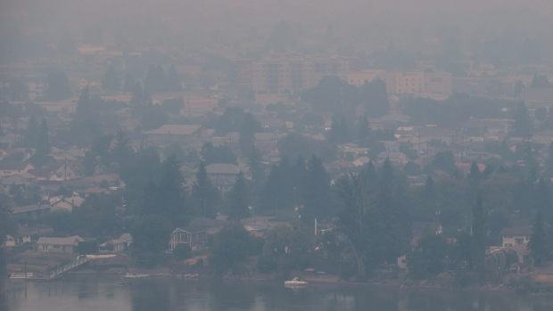 Smoke from wildfires burning in central B.C. shrouds the north shore of Kamloops, B.C., on Monday July 10, 2017. More than 200 wildfiresare burning in the province and an estimated 14,000 people have been evacuated from their homes. THE CANADIAN PRESS/Darryl Dyck