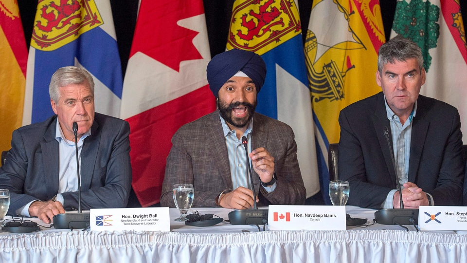 Newfoundland and Labrador Premier Dwight Ball, left, and Nova Scotia Premier Stephen McNeil, right, look on as Economic Development Minister Navdeep Bains fields a question during a news conference at an Atlantic growth strategy meeting in Steady Brook, Newfoundland and Labrador on Tuesday, July 11, 2017. (THE CANADIAN PRESS/Andrew Vaughan)