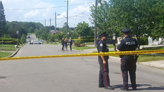 Police are seen responding to a shooting in the area of Jane Street and Sheppard Avenue.