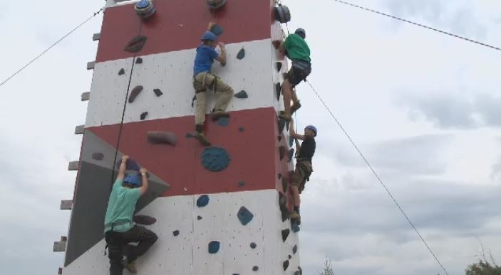 Scouts practice rock climbing at the Canadian Scout Jamboree in Elderbank, N.S.
