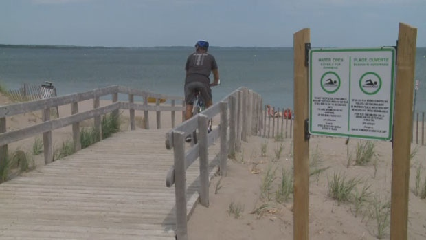 While the signage at Parlee Beach on Tuesday said the water quality is good, some were hesitant to jump in for a swim.
