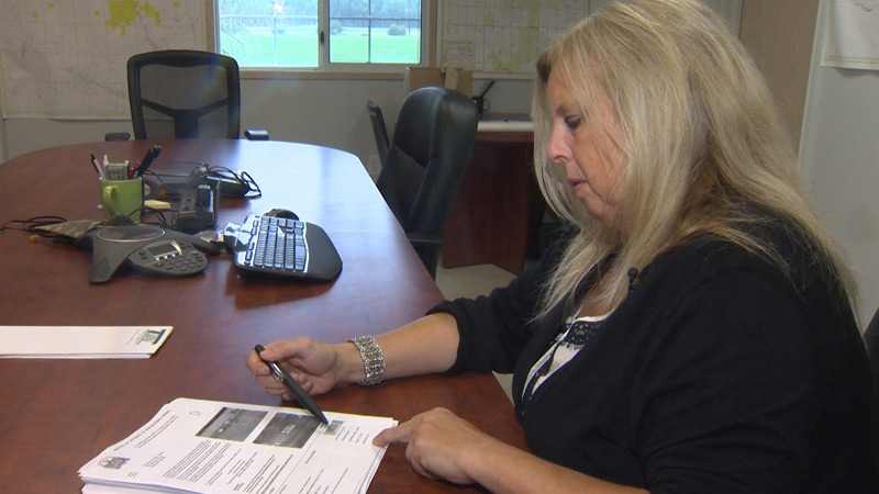 Ponoka resident Charlotte Munkedal looks at a speeding ticket she received from the City of Edmonton, after her licence plate was stolen.
