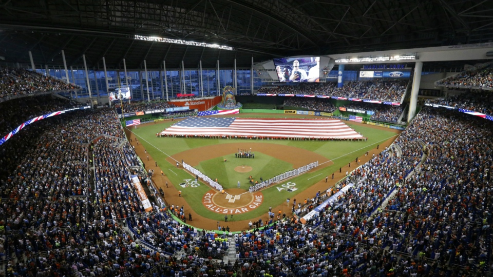 The National Anthem is played during the MLB baseball All-Star Game in Miami on Tuesday, July 11, 2017. (AP / Wilfredo Lee)