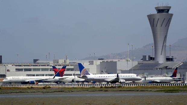 Departing and parked aircraft intersect at San Francisco International Airport, Tuesday, July 11, 2017, in San Francisco. (AP Photo/Marcio Jose Sanchez)