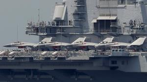 The Liaoning, China's first aircraft carrier, departs Hong Kong, Tuesday, July 11, 2017. (AP Photo/Kin Cheung)