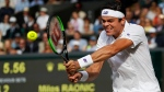Canada's Milos Raonic returns to Switzerland's Roger Federer during their Men's Singles Quarterfinal Match on day nine at the Wimbledon Tennis Championships in London Wednesday, July 12, 2017. (AP Photo / Kirsty Wigglesworth)
