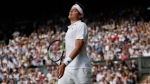 Canada's Milos Raonic reacts as he plays his Men's Singles Quarterfinal Match against Switzerland's Roger Federer on day nine at the Wimbledon Tennis Championships in London Wednesday, July 12, 2017. (AP Photo/Kirsty Wigglesworth)