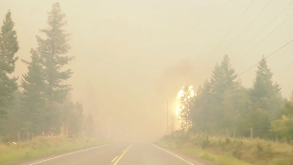 A wildfire burns by the side of the highway in British Columbia's West Chilcotin region in this handout photo taken from video. CANADIAN PRESS/HO Twitter, Sally Aitken