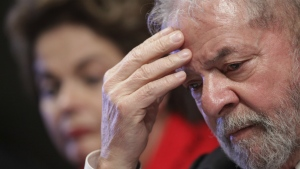 Brazil's Former President Luiz Inacio Lula da Silva attends the inauguration ceremony for the new leadership of the Workers' Party, with ousted President Dilma Rousseff, behind, in Brasilia, Brazil on July 5, 2017. (AP / Eraldo Peres)