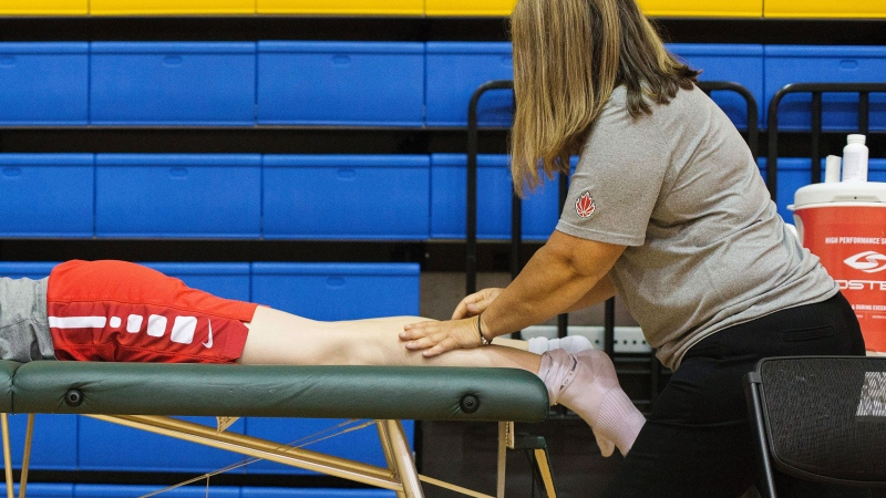 Kim Gaucher of the 2016 Canadian Women's Olympic Basketball Team receives physiotherapy during a media availability in Toronto on Monday, July 25, 2016. THE CANADIAN PRESS/Michelle Siu