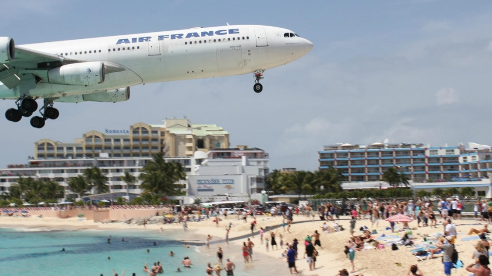 In this file photo, an aircraft flies over Maho Beach as it approaches Princess Juliana International Airport in St. Maarten. (hijodi / TripAdvisor)