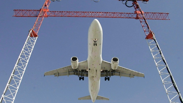 An Air Canada flight makes its final approach as it lands at Pearson International Airport in Toronto on Sept. 30, 2004. THE CANADIAN PRESS/Adrian Wyld