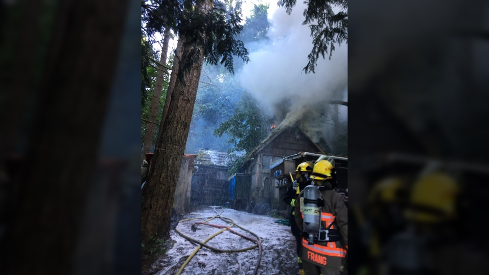 A cabin home on Sooke Road was destroyed by flames and water damage after a series of fast-moving spot fires broke out along the route Wed., July 12, 2017. (Stephanie Dunlop/Metchosin Fire)