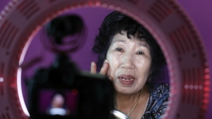 South Korea's YouTube star, Park Makrye, 70, gives a demonstration of make-up tutorials for her YouTube channel during an interview at her home in Yongin, South Korea on July 11, 2017. (AP / Lee Jin-man)