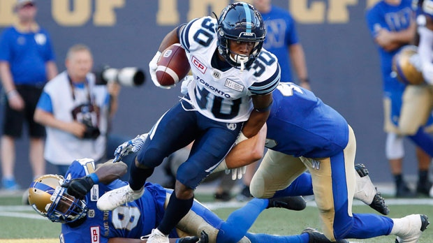 Toronto Argonauts' Martese Jackson (30) returns a Winnipeg Blue Bombers' kick for the touchdown during the first half of CFL action in Winnipeg Thursday, July 13, 2017. (THE CANADIAN PRESS/John Woods)