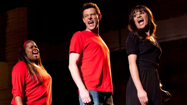 "In this undated image released by Fox, cast members, from left, Amber Riley, Cory Monteith and Lea Michele perform during a scene from ""Glee."" (AP Photo/Fox, Adam Rose, File)"