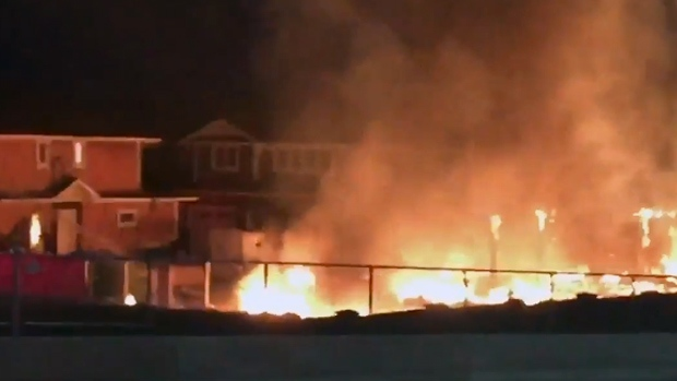 Fire engulfed a building under construction in the Stonebridge neighbourhood early Friday morning. (SOURCE: @STATEMS1)